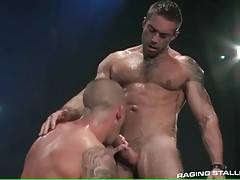 Sexy muscled lovers get more and more turned on.