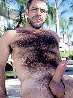 Hot hairy bear with a penis ring shows off his massive body and cock