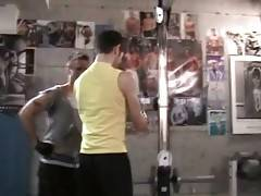 Toned studs get horny in gym while working out.