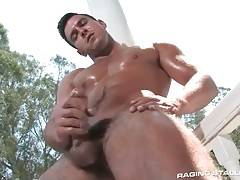 Hot muscled stud Paddy O`Brian skillfully works his hand.