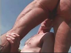 Two horny dudes are taking care of each other poolside.