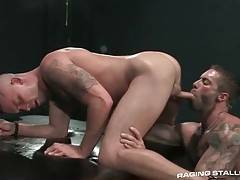 Horny dude slurps buddy`s boner from the rear.