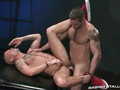 Turned on muscled dudes are making awesome love.